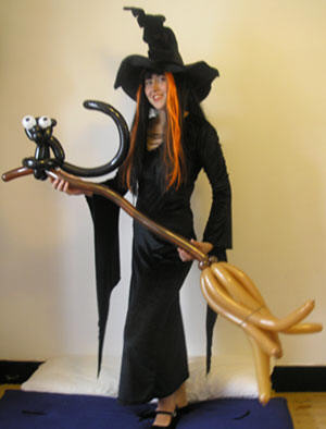 A balloon modelling witch..one of many character balloon modellers available.