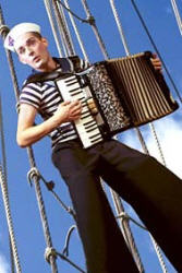 Accordian playing Russian Sailor stiltwalker