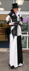 Stiltwalking black and white Jester
