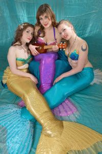 three sirens or mermaids