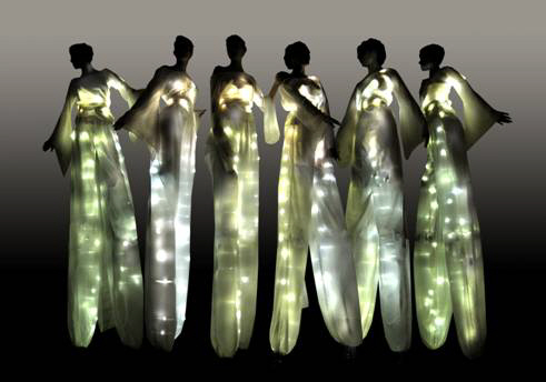 Illuminated stiltwalkers for night time events.