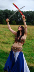 Caitlyn Bellydancer with crossed swords - to book contact www.circusperformers.co.uk