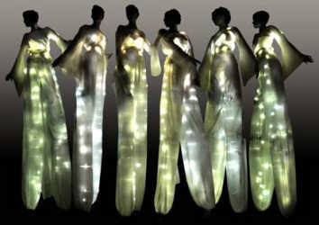 Elegantly illuminated stiltwalking costumes. Perfect stiltwalkers for night time events