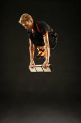 Jon jumping over cigar boxes