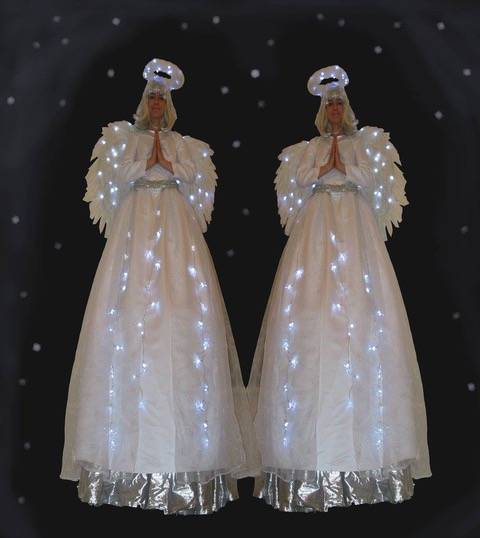 Christmas angels on stilts