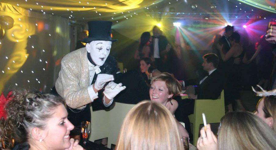 Mime working at tables in a club